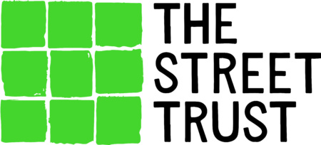 The Street Trust logo - nine high visibility green squares arranged in a square,separated by thin white lines
