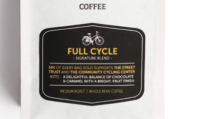 """A bag of coffee that reads """"full cycle signature blend. 50 cents of everybag sold supports The Street Trust and Community Cycling Center. Notes: a delightful balance of chocolate and caramel, with a bright"""