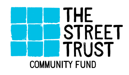 The Street Trust Community Education Fund logo features a blue grid of nine city blocks separated by thin white lines.