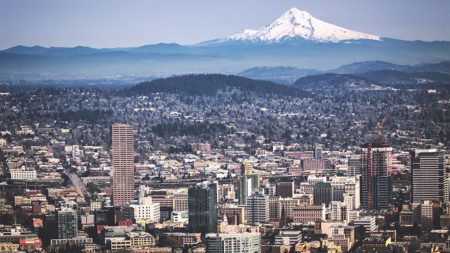 An aerial view of Portland Oregon with Mt. Hood in the distance.
